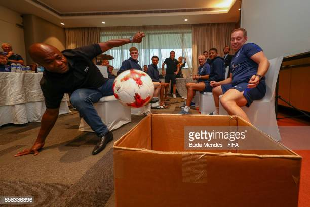 Legend Emmanuel Amunike jokes with players and the head coach Steven Cooper of England during a FIFA Ethics Workshop ahead of the FIFA U-17 World Cup...