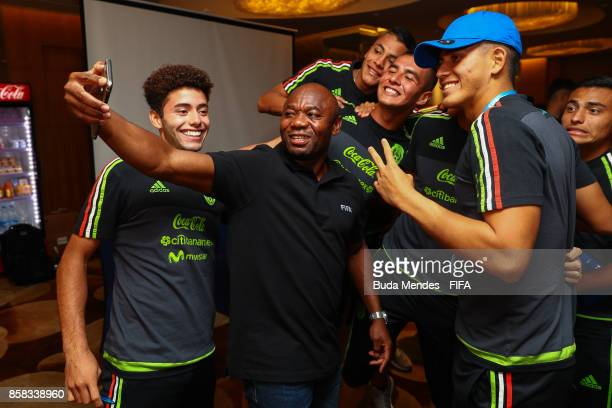 Legend Emmanuel Amunike take a selfie with players of Mexico during a FIFA Ethics Workshop ahead of the FIFA U-17 World Cup India 2017 tournament at...