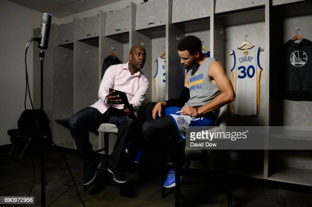 Legend Gary Payton chats with Stephen Curry of the Golden State Warriors during Facebook Live at practice and media availability as part of the 2017...