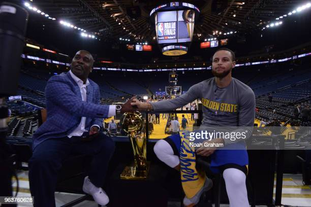 Legend Gary Payton speaks to Stephen Curry of the Golden State Warriors during practice and media availability as part of the 2018 NBA Finals on MAY...