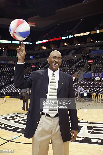 Legend George Gervin spins a ball on his finger before the start of Game one of the 2003 NBA Finals between the San Antonio Spurs and the New Jersey...