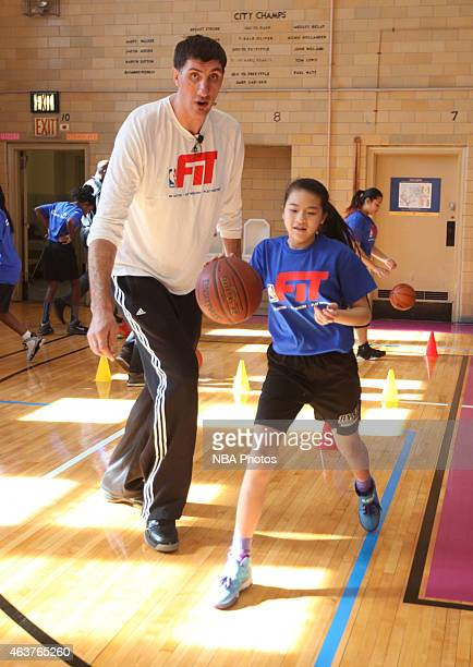 Legend Gheorge Muresan participates in NBA Cares/FIT Day of Service at JHS 216 George J Ryan school during the 2015 NBA AllStar on February 13 2015...