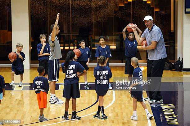 NBA legend Gheorghe Muresan coaches participants during a Hoops for Troops clinic after USA Men's Senior National Team practice at George Washington...