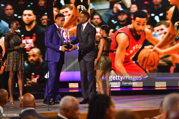 Legend Grant Hill and Jada PinkettSmith presents Malcolm Brogdon of the Milwaukee Bucks with the Rookie of the Year award during the 2017 NBA Awards...
