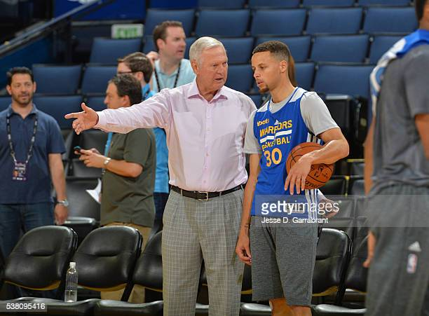 Legend Jerry West chats with Stephen Curry of the Golden State Warriors during practice and media availability as part of the 2016 NBA Finals on June...