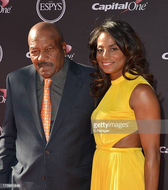 NFL legend Jim Brown and wife Monique Brown arrive at the 2013 ESPY Awards at Nokia Theatre LA Live on July 17 2013 in Los Angeles California