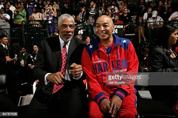 NBA legend Julius Erving talks with Harlem Globetrotter Curly Neal during the McDonald's AllStar Celebrity Game on center court during NBA Jam...