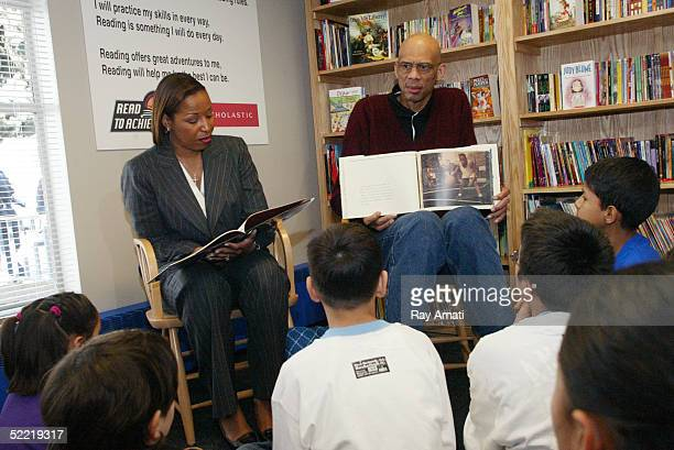 NBA legend Kareem AbdulJabbar and the WNBA's Cynthia Cooper read to children after the ceremonies in which the NBA and the Denver Nuggets dedicated...