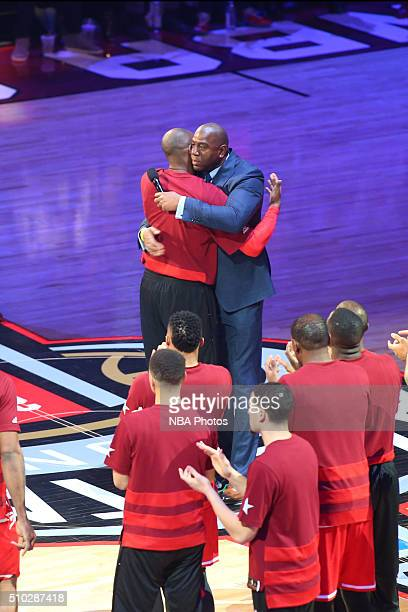 Legend Magic Johnson and Kobe Bryant of the Western Conference AllStars hug during the NBA AllStar Game as part of the 2016 NBA AllStar Weekend on...