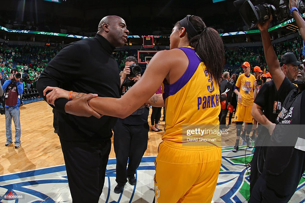Legend, Magic Johnson congratulates Candace Parker #3 of the Los Angeles Sparks after Game Five of the 2016 WNBA Finals against the Minnesota Lynx on October 20, 2016 at Target Center in Minneapolis, Minnesota.