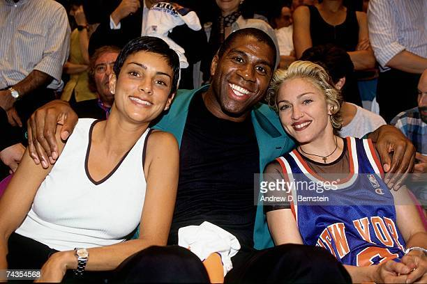 Legend Magic Johnson poses with singer Madonna during Game Four of the NBA Finals played on June 15 1994 at Madison Square Garden in New York New...