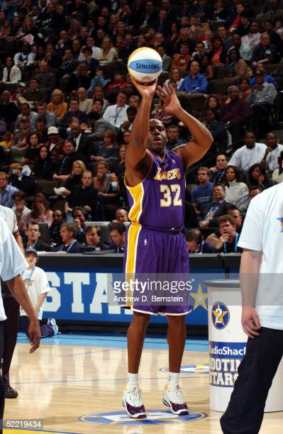 NBA legend Magic Johnson shoots during the Radioshack Shooting Stars competition during the 2005 NBA AllStar Saturday Night at Pepsi Center on...
