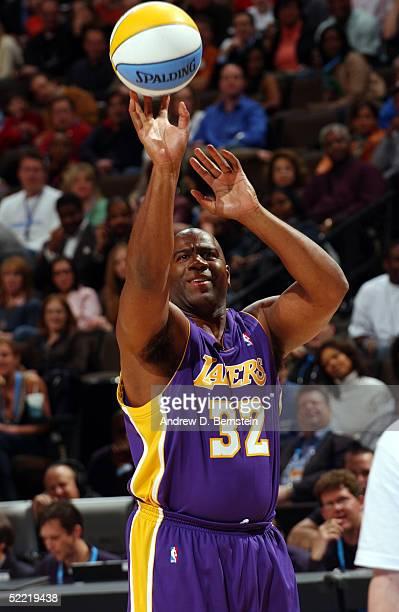NBA legend Magic Johnson shoots during the Radioshack Shooting Stars competition during the 2005 NBA AllStar Saturday Night at Pepsi Center on...