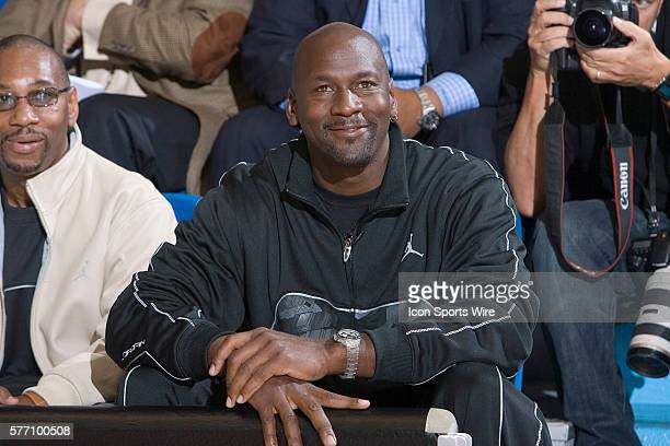 NBA legend Michael Jordan seating next to Larry Miller the president of Nike division Jordan attends the Jordan Classic a contest between the 30 best...