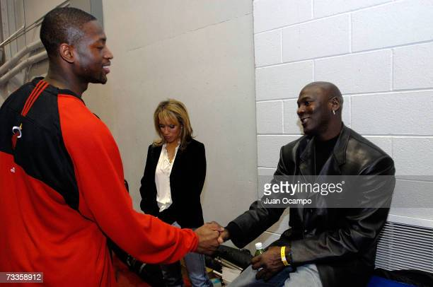 Legend Michael Jordan shakes hands with Dwyane Wade of the Miami Heat before the Sprite Slam Dunk Competition at NBA All-Star Weekend on February 17,...