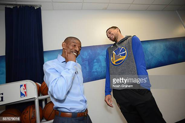 Legend Muggsy Bogues chats with Stephen Curry of the Golden State Warriors during media availability as part of the 2016 NBA Finals on June 1 2016 at...