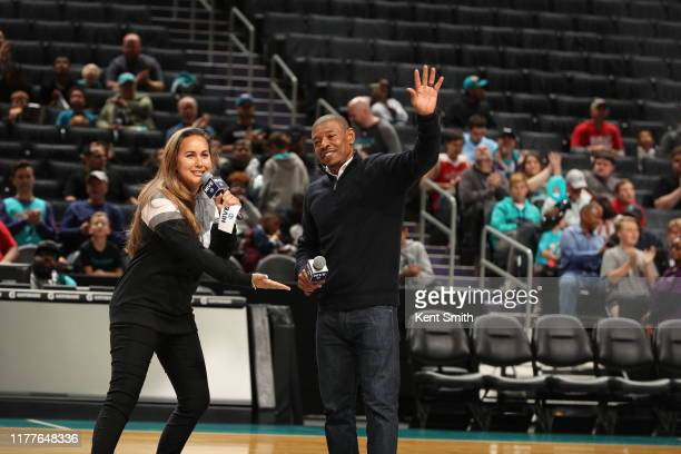 Legend Muggsy Bogues waves to thr crowd during the scrimmage on October 18 2019 at Spectrum Center in Charlotte North Carolina NOTE TO USER User...