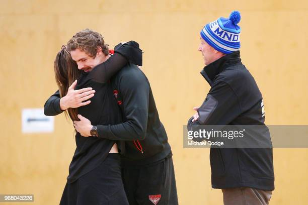 Legend Neale Daniher watches Joe Daniher of the Bombers hug his daughter Bec during an Essendon Bombers AFL media opportunity at The Hangar on June 6...