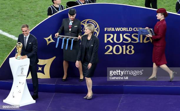 Legend Philipp Lahm places the World Cup Trophy on its plinth before it is awarded to France after the 2018 FIFA World Cup Final between France and...