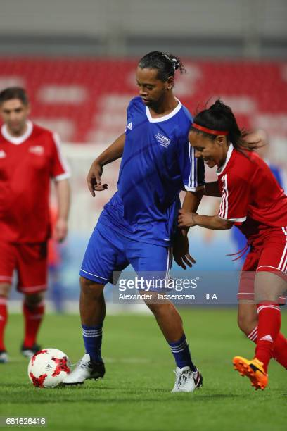 Legend Ronaldinho of Brazil battles for the ball with FIFA Legend Alex Scott during a FIFA Football Tournament ahead of the 67th FIFA Congress at...