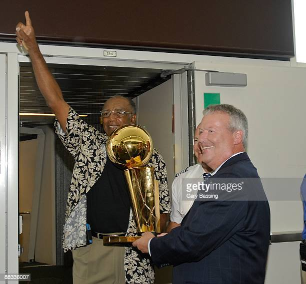 NBA legend Sam Jones presents Orlando Mayor Buddy Dyer with the Larry O'Brien Trophy at Orlando International Airport on June 8 2009 in Orlando...