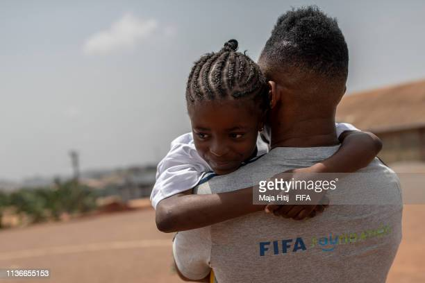 Legend Samuel Eto'o carries a girl during his visit in school, event organized by FIFA Foundation-supported NGO, Sport and Cooperation Network, on...