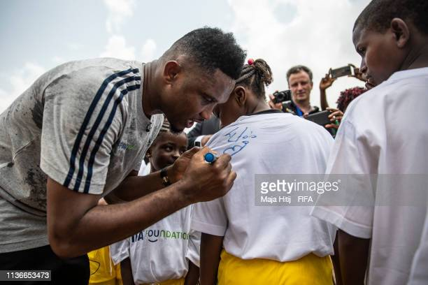 Legend Samuel Eto'o gives an autographs during his visit in school event organized by FIFA Foundationsupported NGO Sport and Cooperation Network on...