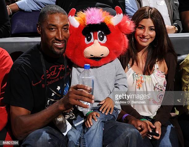 NBA legend Scottie Pippen and his wife Larsa Pippen watch the Foot Locker ThreePoint Shootout on AllStar Saturday Night part of 2009 NBA AllStar...