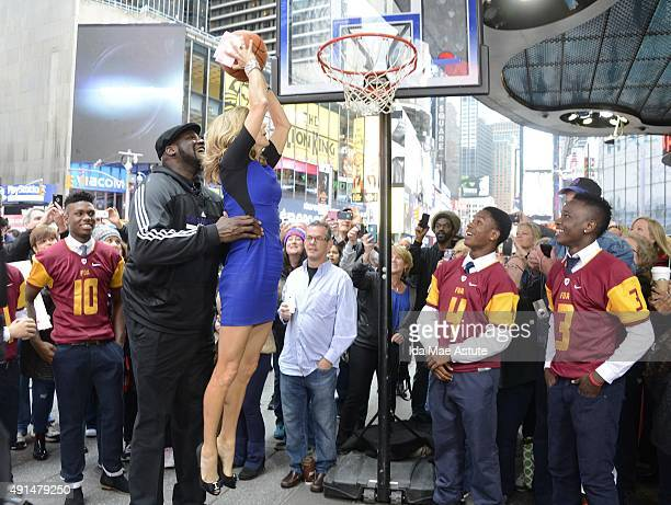 AMERICA NBA legend Shaquille O'Neal shows Lara Spencer how to dunk on GOOD MORNING AMERICA 10/5/15 airing on the Walt Disney Television via Getty...