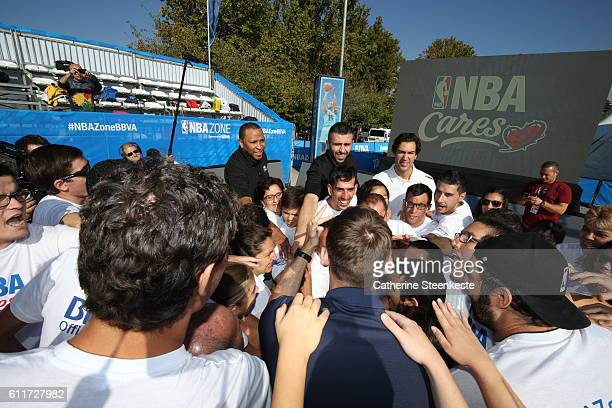 Legend Shawn Marion and Lorenzo Sanz of Real Madrid pose with participants during the Special Olympics Unified Clinic as part of the 2016 Global...