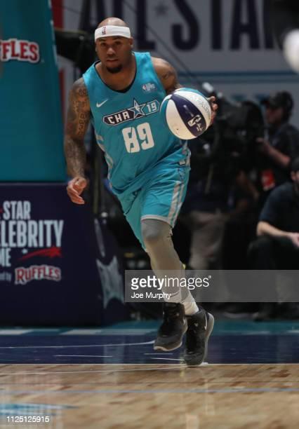 NFL legend Steve Smith Sr #89 dribbles the ball up the court during the 2019 NBA AllStar Celebrity Game on February 15 2019 at Bojangles Coliseum in...