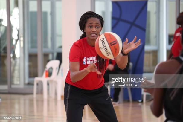 Legend Swin Cash goes over drills with the campers at the Basketball Without Boarders Africa program at the American International School of...