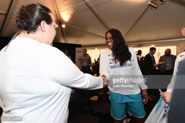 WNBA legend Taj McWilliams greets a team mate before the 2019 NBA All Star Unified Basketball Game on February 15 2019 at Bojangles Coliseum in...