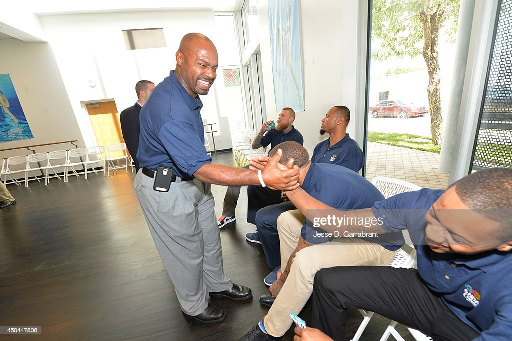 Legend Tim Hardaway greets Mario Chalmers of the Miami Heat at the 2014 NBA Finals Legacy Project as part of the 2014 NBA Finals on June 11, 2014 at the Little Haiti Cultural Complex in Miami, Florida.