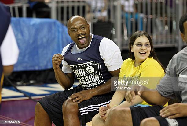 Legend Tim Hardaway laughs during the Legends Challenge on center court at Jam Session during the NBA AllStar Weekend on February 23 2012 at the...
