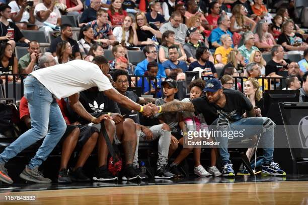Legend Tracy McGrady greets DeMarcus Cousins of the Los Angeles Lakers during the game on July 23 2019 at the Mandalay Bay Events Center in Las Vegas...