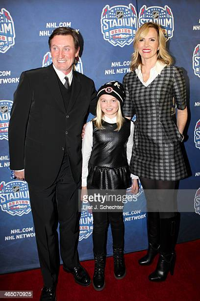 NHL legend Wayne Gretzky daughter Emma Gretzky and his wife Janet Gretzky walk the red carpet at the 2014 Coors Light NHL Stadium Series between the...
