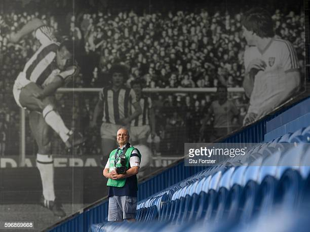 Legend West Bromwich photographer Lawrie Rampling stands infront of his picture of West Brom striker Cyrile Regis taken in an 5th Round FA Cup match...
