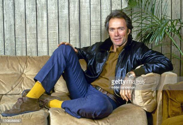 Legendary actor Clint Eastwood relaxes on the couch in his office at Warner Bros Studios in Burbank, California in January 1982. He was making his...