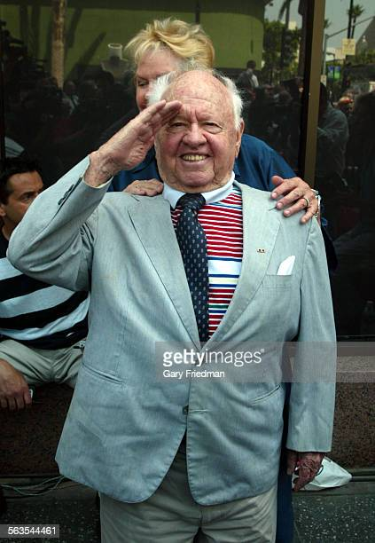 """Legendary actor Mickey Rooney salutes as the intersection of Hollywood and Vine was designated as """"Bob Hope Square."""" This was to mark the occasion of..."""