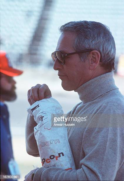 Legendary actor Paul Newman wears sunglasses and eats popcorn as he visits Indanapolis on June 1 1979 in Indianapolis USA