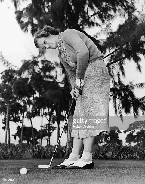Legendary American athlete Babe Didrikson Zaharias stands on a golf course and putts the ball mid 1940s Zaharias was not only a champion golfer but...