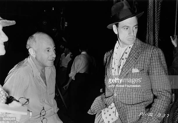 Legendary American director Cecil B. DeMille with actor Gary Cooper , star of 'The Plainsman,' circa 1936.