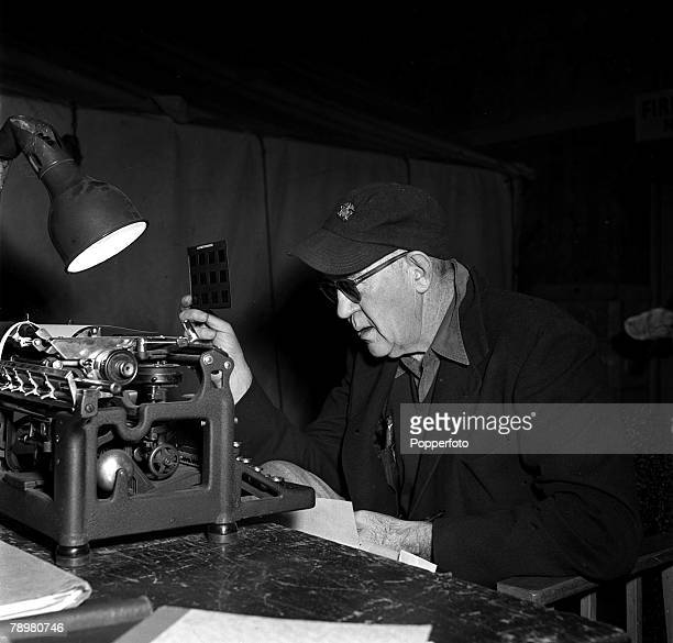 1953 Legendary American Producer Director John Ford looking at stills from the 'Mogambo'