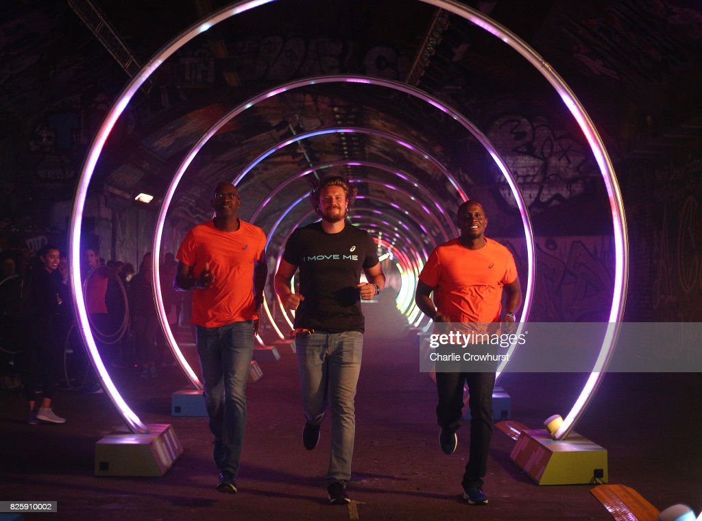 Legendary athletes Allen Johnson, Andreas Thorkildsen and Dwight Phillips attend the launch of ASICS Run The Tube experience, an epic 85-metre LED tunnel made from hoops of light. Run The Tube is part of ASICS#IMoveLondon campaign that aims to inspire Londoners to move more and use their city as their gym on August 3, 2017 in London, England.