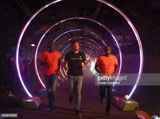 Legendary athletes Allen Johnson Andreas Thorkildsen and Dwight Phillips attend the launch of ASICS Run The Tube experience an epic 85metre LED...
