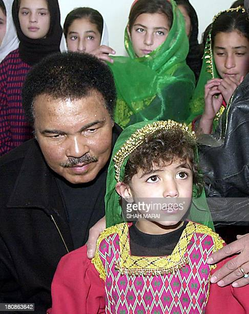 Legendary boxer Muhammad Ali visits a girls' school in Kabul 18 November 2002 Ali a UN peace messenger is on a threeday visit to Afghanistan to draw...