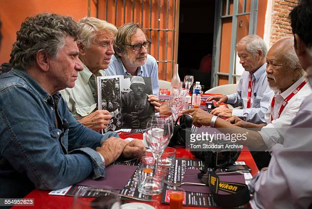 Legendary British war photographer Don McCullin pictured with Vietnamese photographers who covered the war with the North Vietnamese side The...