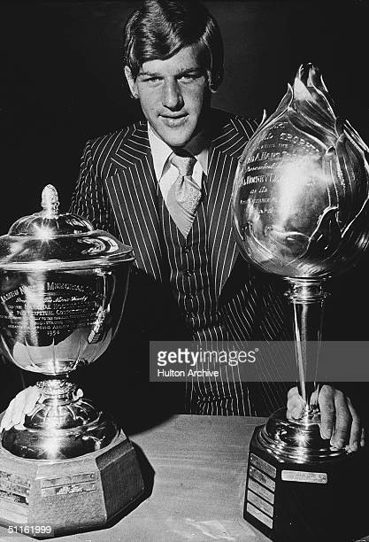Legendary Canadian hockey player Bobby Orr stands with two of his trophies the Hart memorial Trophy given to the player in the league considered most...