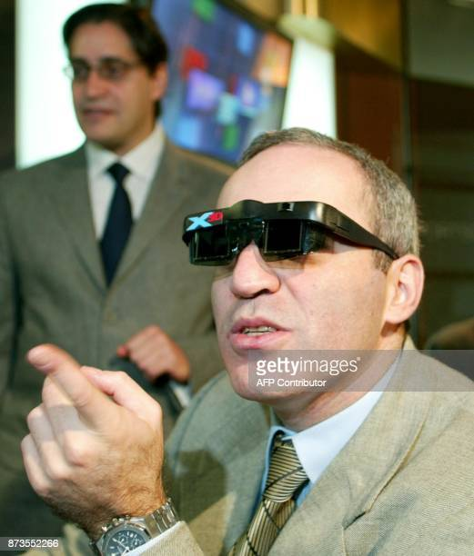 Legendary chess champion Garry Kasparov wears his X3D viewing glasses as he demonstrates how he will compete against the X3D Fritz computer program...